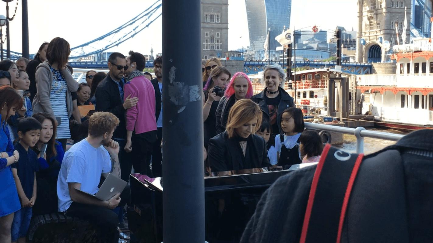 Yoshiki playing piano at Tower Bridge