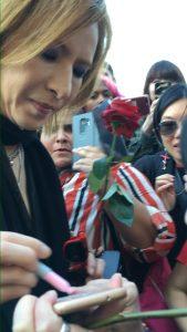 Yoshiki giving autograph