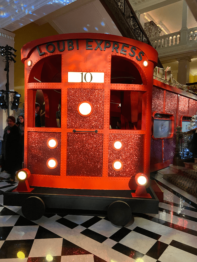 Sparkling Christmas train at Claridge Hotel