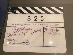 Clapperboard used during filming of No Time To Dies signed by the cast