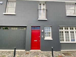Red door in a grey building London